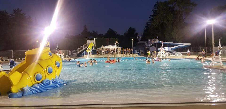 Swimmers at pool for a later night swim event